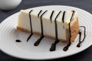 Slice of cheesecake with liquorice sauce